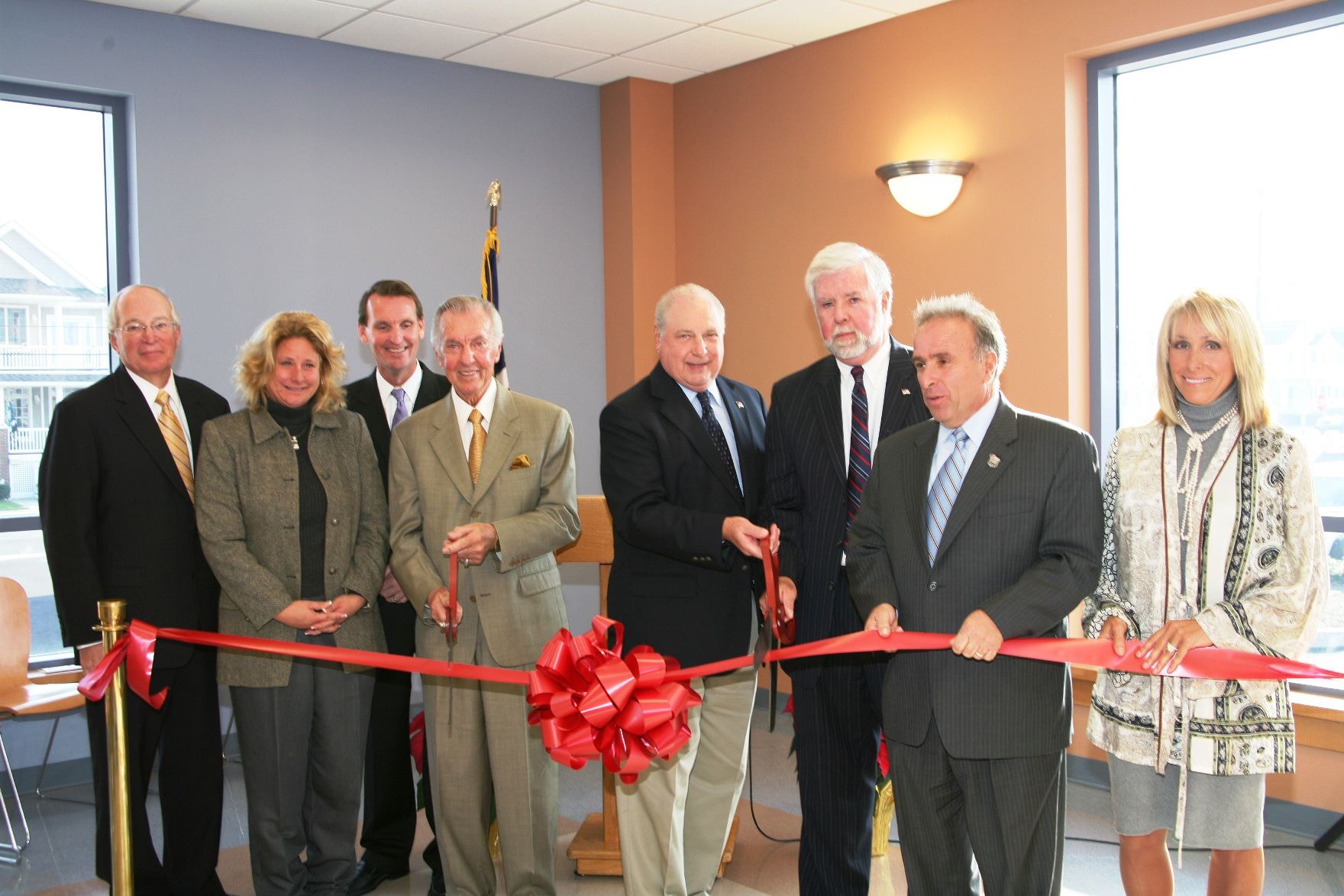 Men and women cutting ribbon at Ocean City Stainton Senior Center