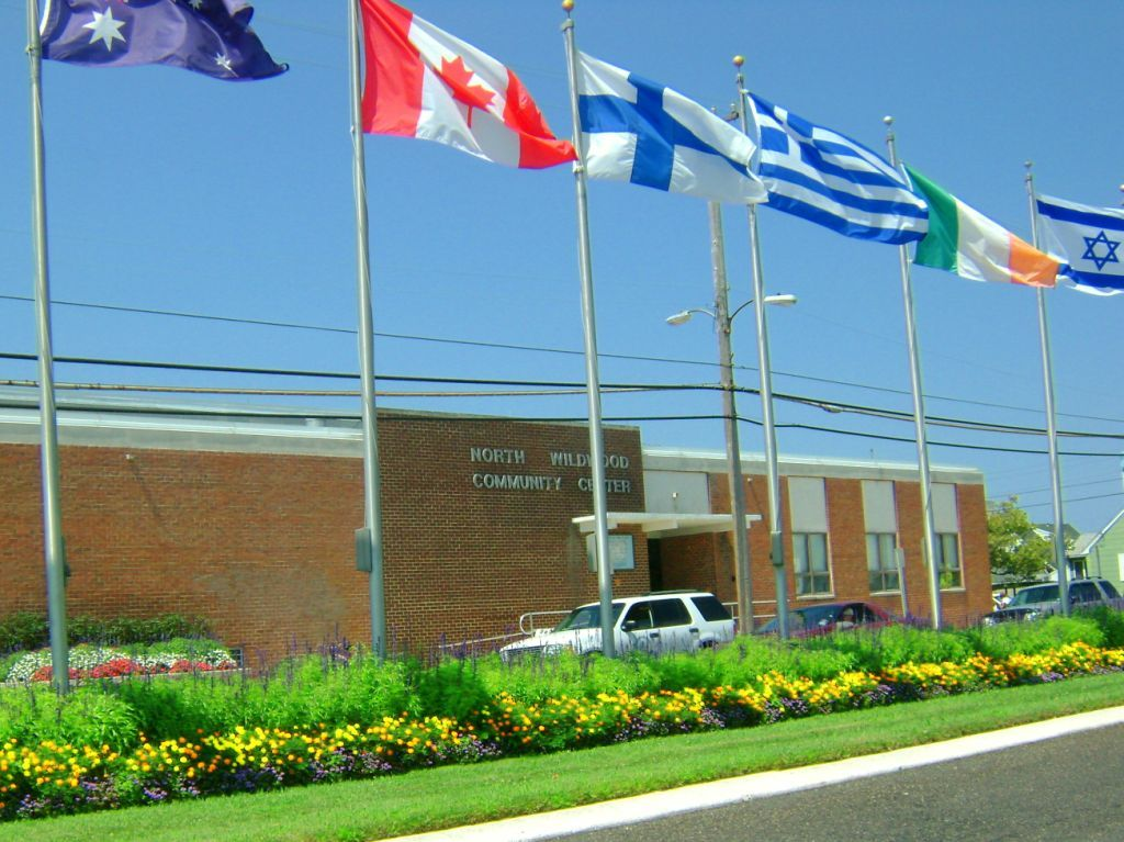 North Wildwood Senior Center building with country flags outside