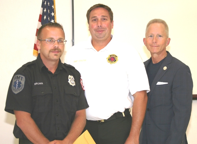 Fire Fighter II graduate, Jonathan Brown with Cape May City Fire Chief Alex Coulter and Senator Jeff Van Drew