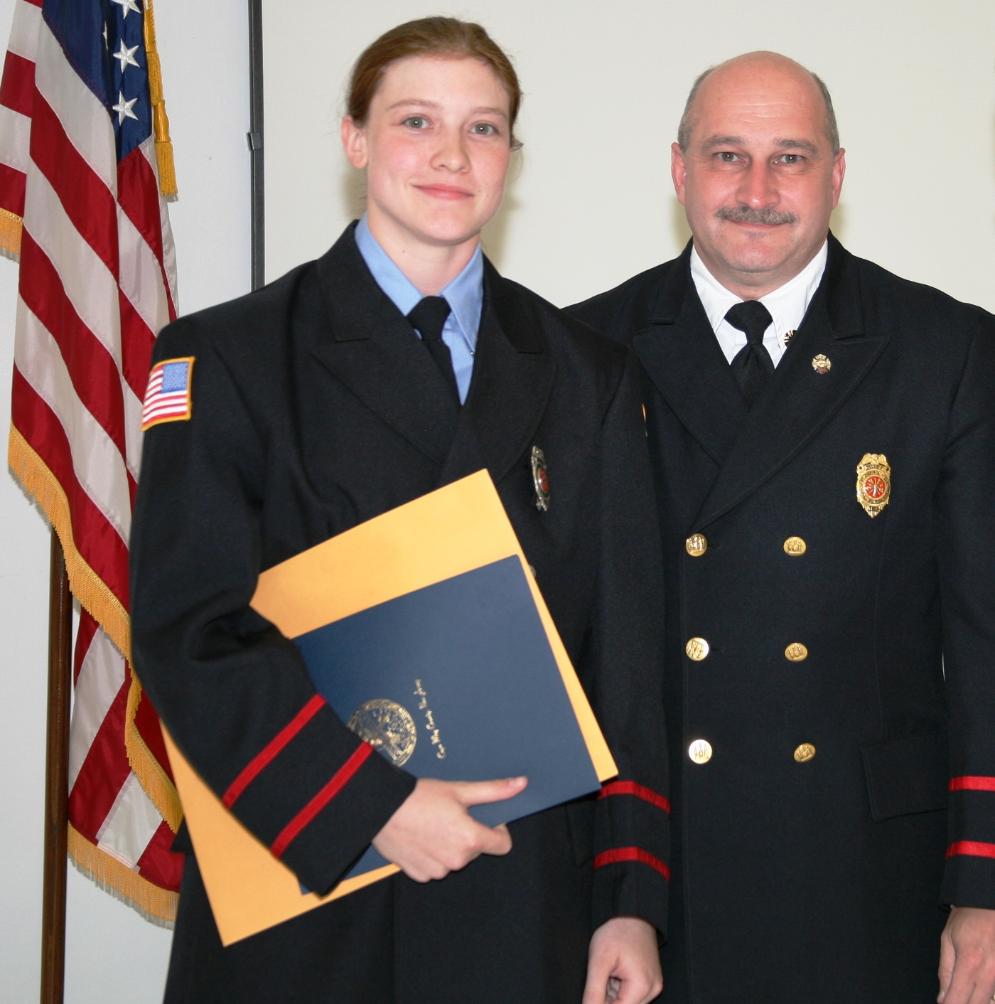 Fire Fighter II Kristen Kolondra, Chief Richard Sweeten